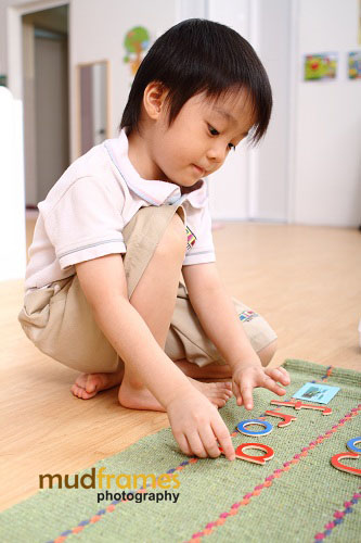 A student playing at San Lorenzo Montessori, Publika, Solaris Dutamas