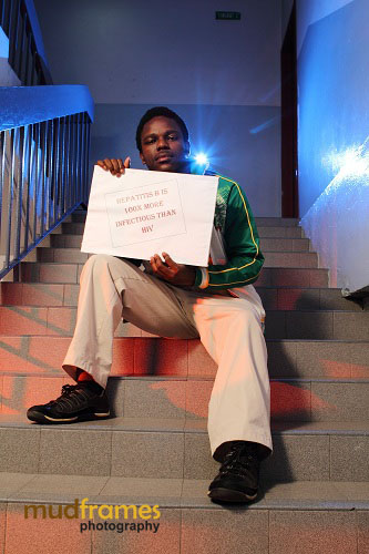 Stamford College's student with World Hepatitis Day 2012 placard message