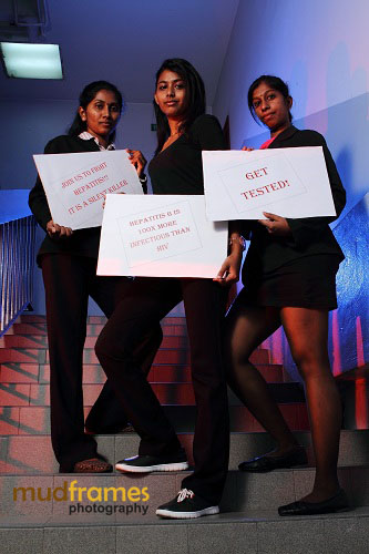 Stamford College's students with World Hepatitis Day 2012 placard message