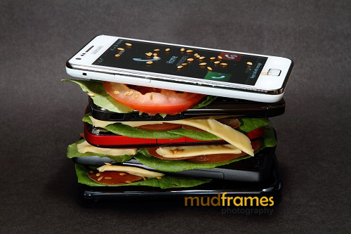 Hamburger made with layers of mobile phones