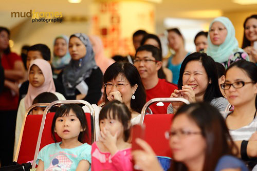 Audience watching jazzercise performing at the World Hepatitis Day 2012 main event at One Utama Shopping Mall