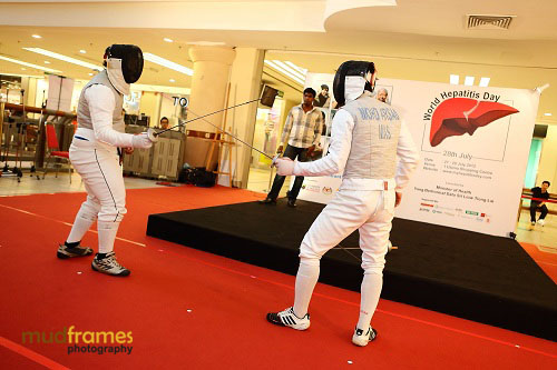 Fencers at the World Hepatitis Day 2012 main event at One Utama Shopping Mall