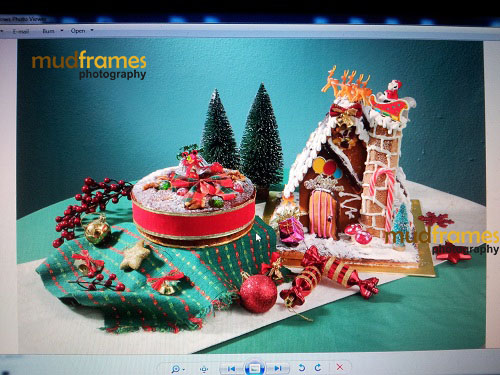 Behind-the-scenes photo shoot for Cold Storage ginger bread man house and fruit cake