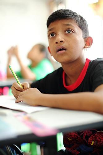 A Myanmar child refugee studying at PBCC Learning Centre in Selayang