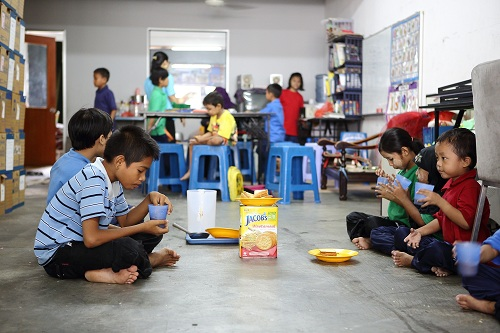 Myanmar children refugees having lunch at PBCC Learning Centre in Selayang