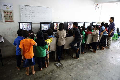 Myanmar children refugees using donated computers by Rentwise at PBCC Learning Centre in Selayang