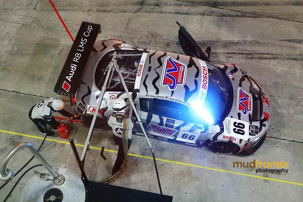 An Audi R8 at a pit stop during MMER 2013 at Sepang