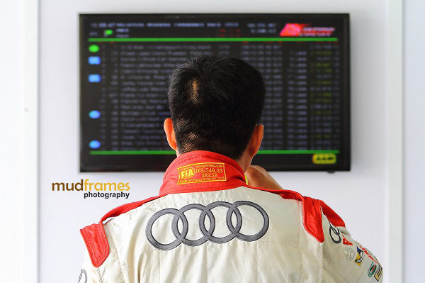 An Audi R8 race driver checks the LCD screen for current race positions during MMER 2013 at Sepang
