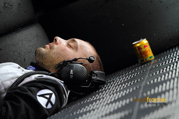 A crashed out Audi race crew snoozing at the pit during MMER 2013 at Sepang