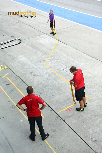 Audi race crew laying down the lines at pit for MMER 2013 at Sepang