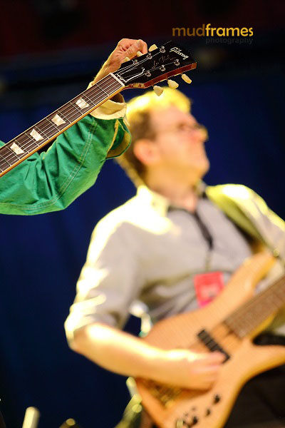 Lee Mack Ritenour tuning his guitar on stage during the KL International Jazz Festival 2013