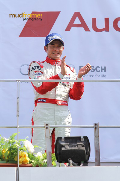 Race driver Aaron Kwok at podium after Round 8 of the Audi R8 LMS Cup 2013 at Sepang