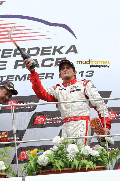 Race driver Alex Yoong celebrating at podium during MMER 2013 at Sepang