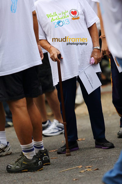 A participant on a walking stick at taman keliling during World Arthritis Day 2013