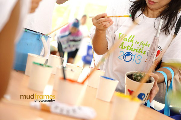 Participants painting flower pots at NCWO during World Arthritis Day 2013