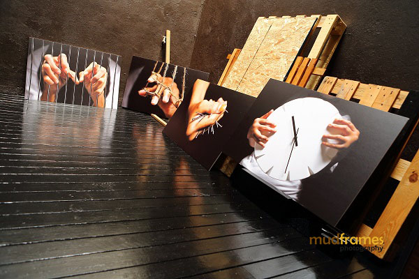 Photography art pieces in Mudframes Studio showing fingers of arthritic patients as part of a worldwide art campaign