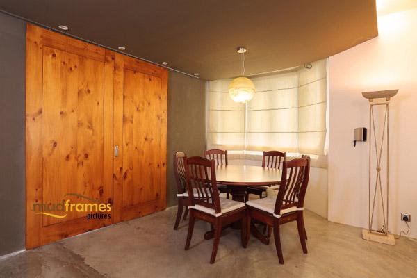 Interior photography of condo dining area