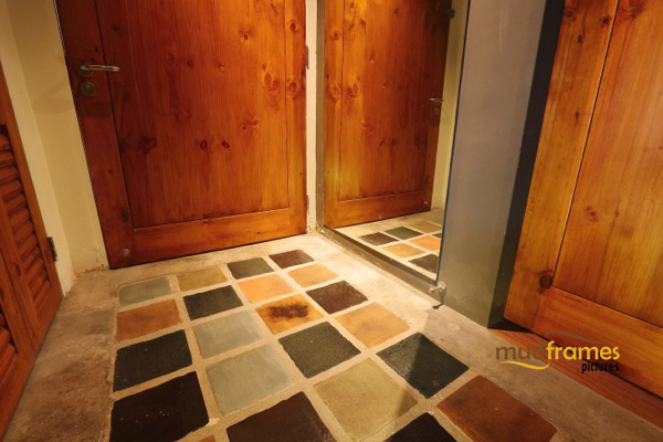 Interior photography of tiled entrance to condo