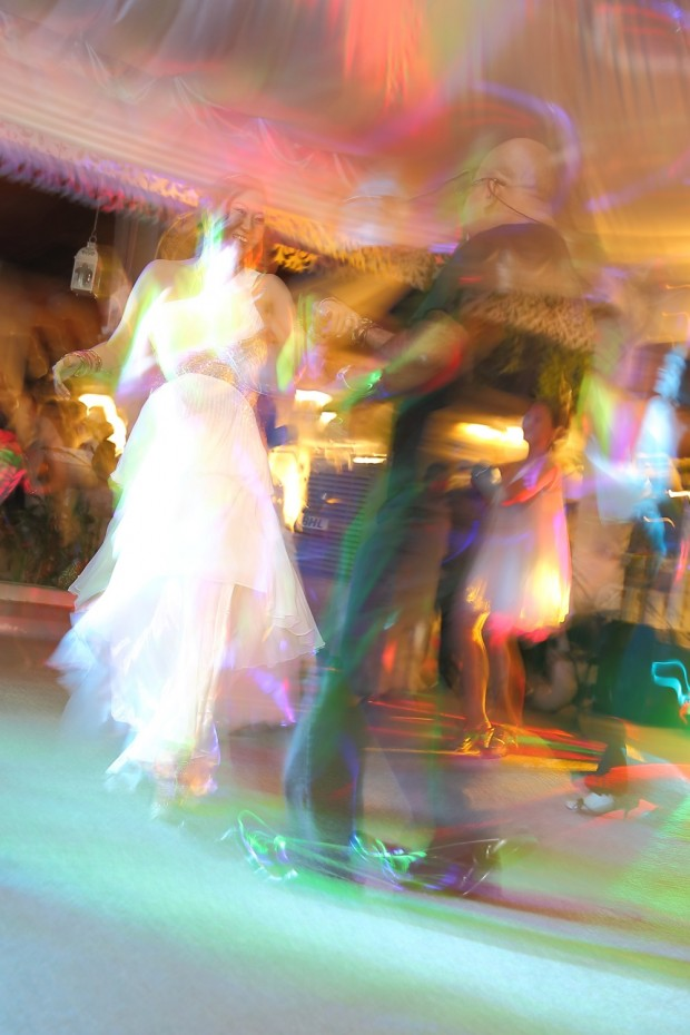 A dancing bride during wedding dinner reception at Passion Road
