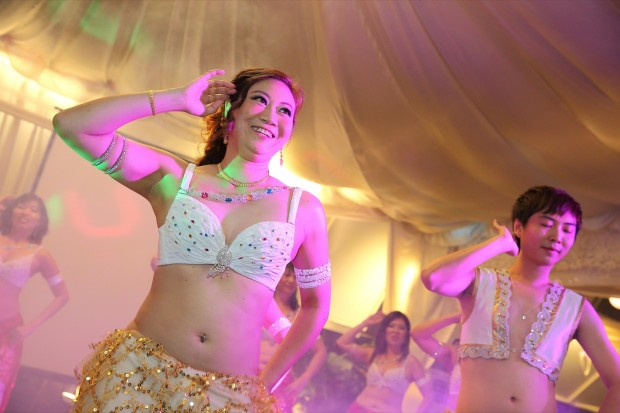 Belly dancing during wedding dinner reception at Passion Road