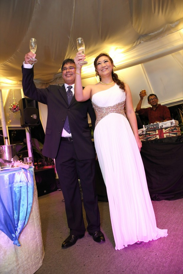 Bride and groom toasting to their guests at Passion Road