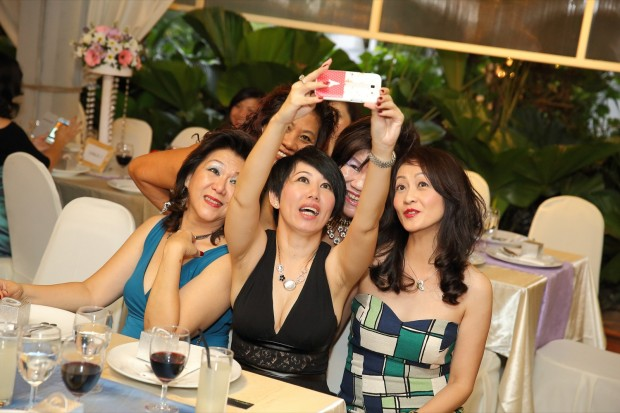 Group selfie during wedding dinner reception at Passion Road