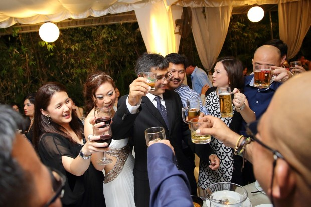 Wedding guests giving a toast to bride and groom at Passion Road