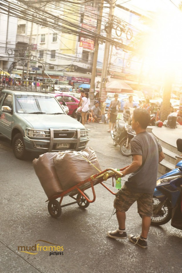 A local Thai pushing his goods on the streets of Bangkok, Thailand