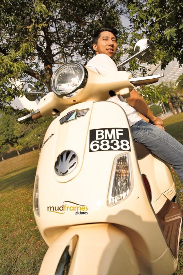 A vespa rider posing at Putrajaya