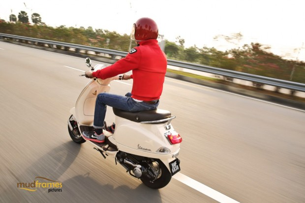 A vespa scooter on the road