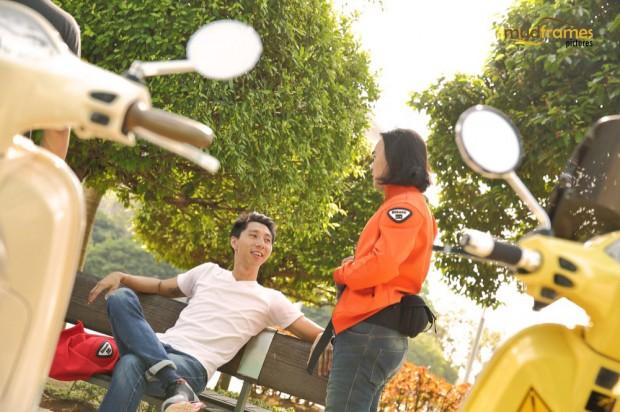 Vespa riders chatting at Putrajaya