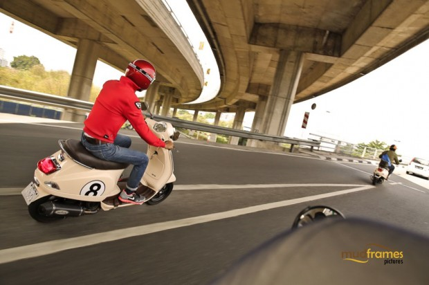 Vespa scooters on the highway