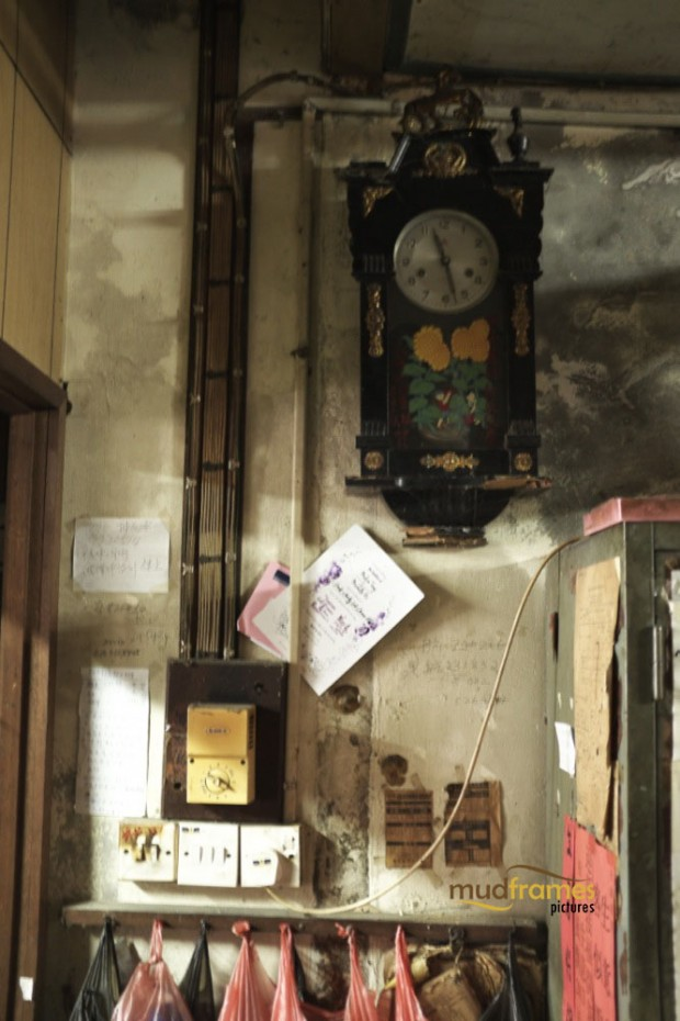 Old wall clock at Kok Ann medical store, a traditional chinese medicine outlet at Kuching, Malaysia