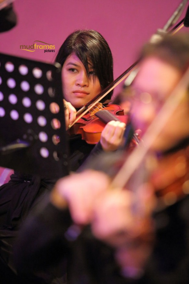 A violinist playing with the UM Big Band Orchestra during the KL International Jazz Festival 2014 at University Malaya's Experimental Theatre