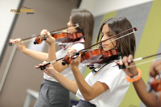 Students playing the violin at the British International School of Kuala Lumpur