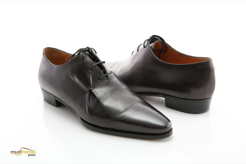Black Berluti shoes on white background