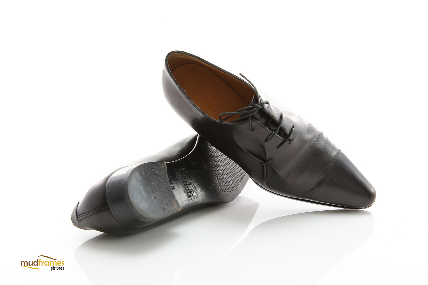 Black Berluti shoes on white background