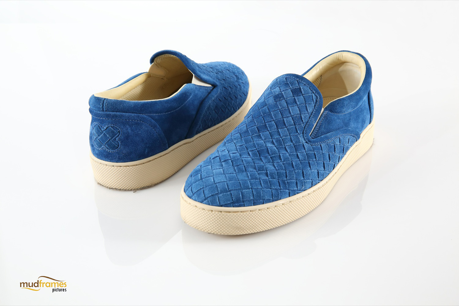 Blue Bottega Veneta shoes on white background