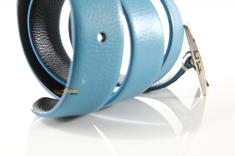 Blue Paul Smith belt on white background
