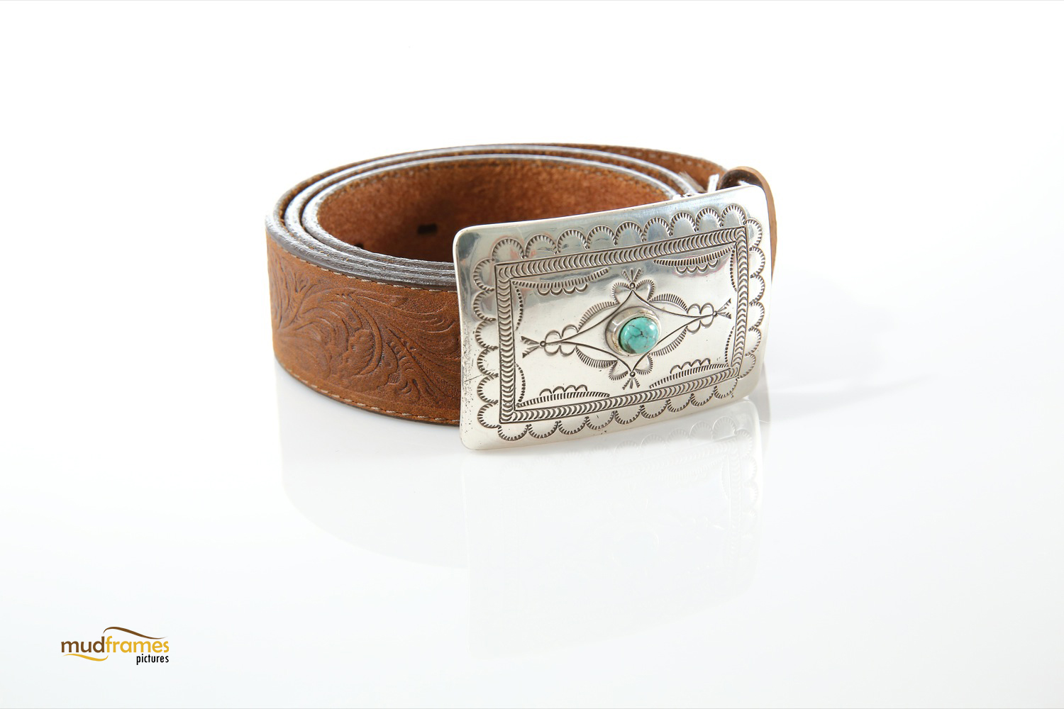 Brown leather belt with silver buckle on white background