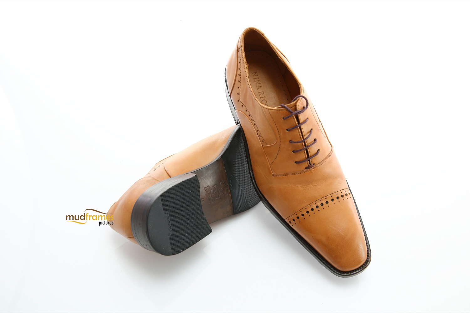 Brown Nina Ricci shoes on white background