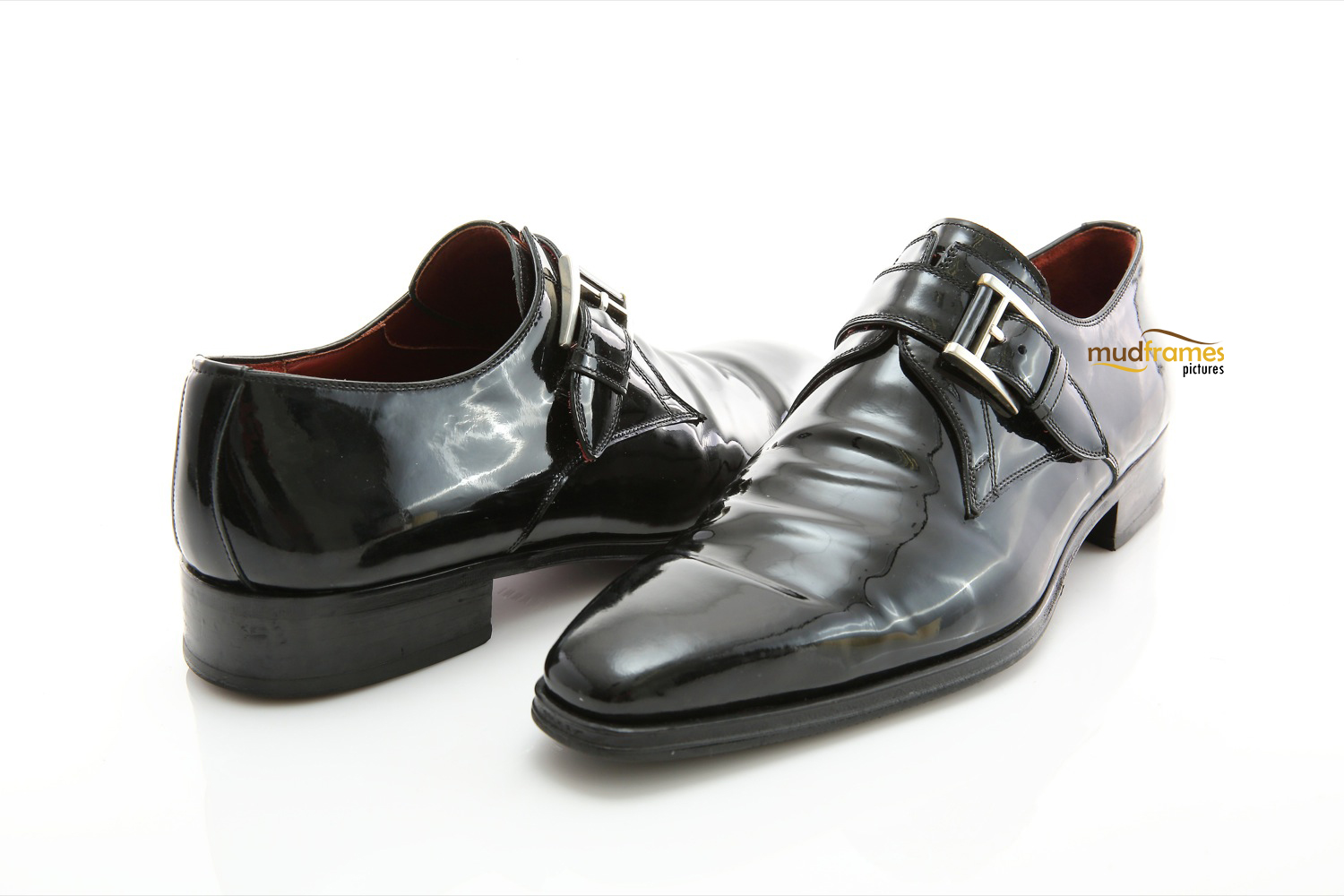 Glossy black shoes on white background