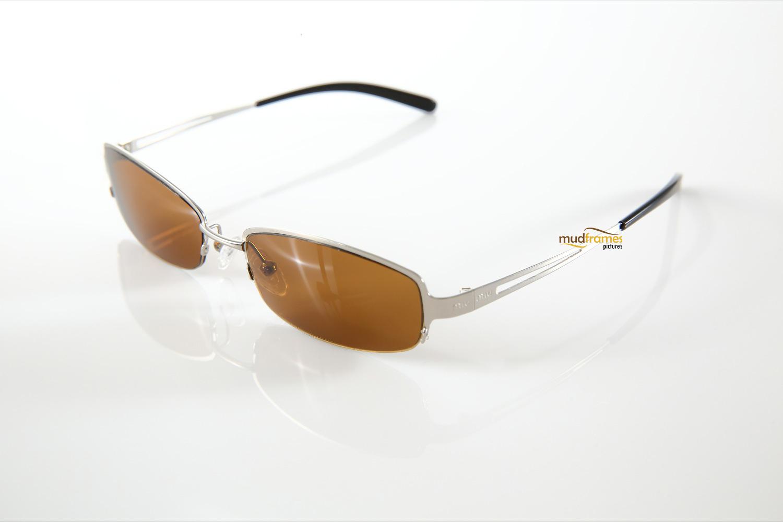 Miu Miu spectacles on white background