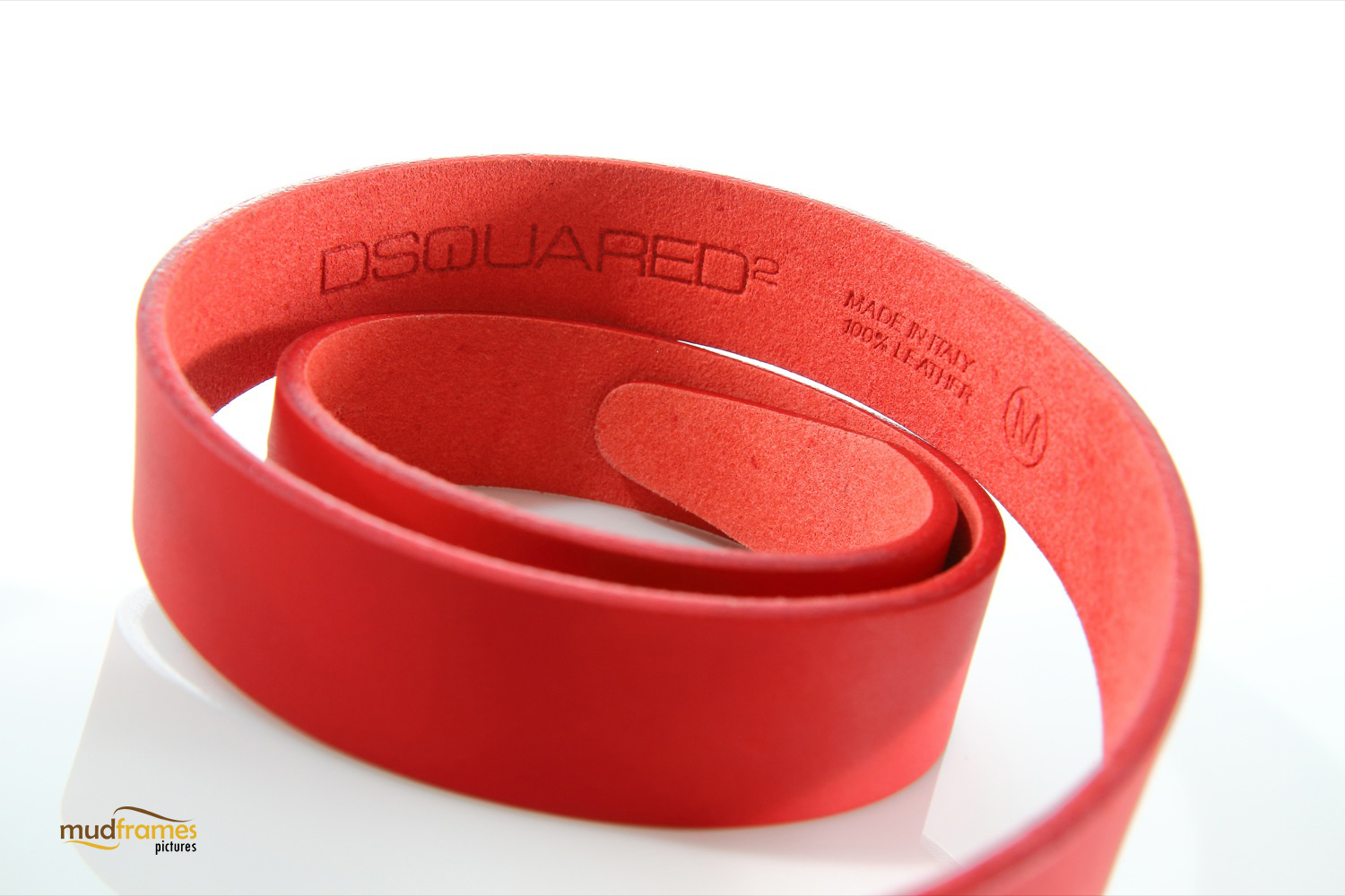 Red Dsquared leather belt on white background