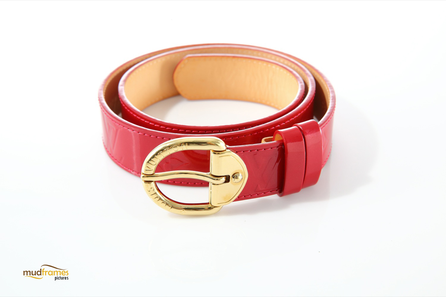 Red Louis Vuitton belt on white background