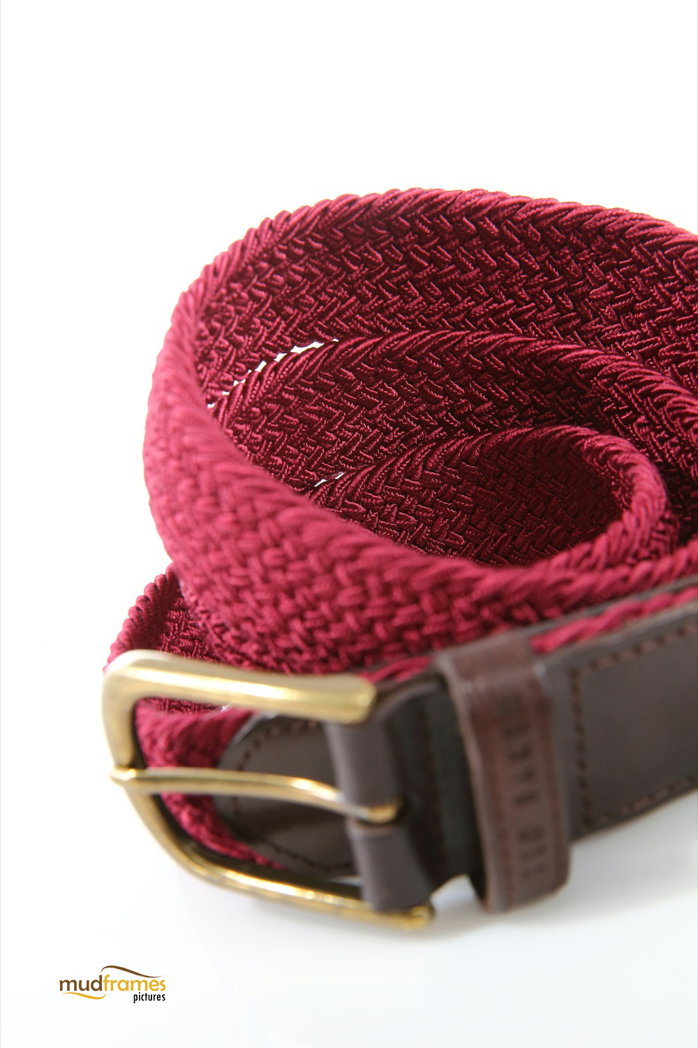 Red Ted Baker belt on white background