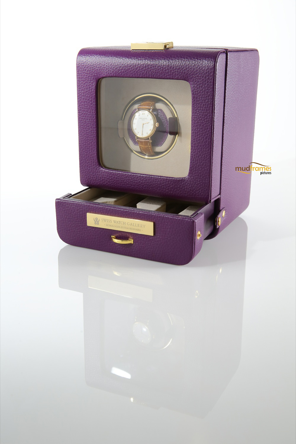 Swiss watch winder on white background