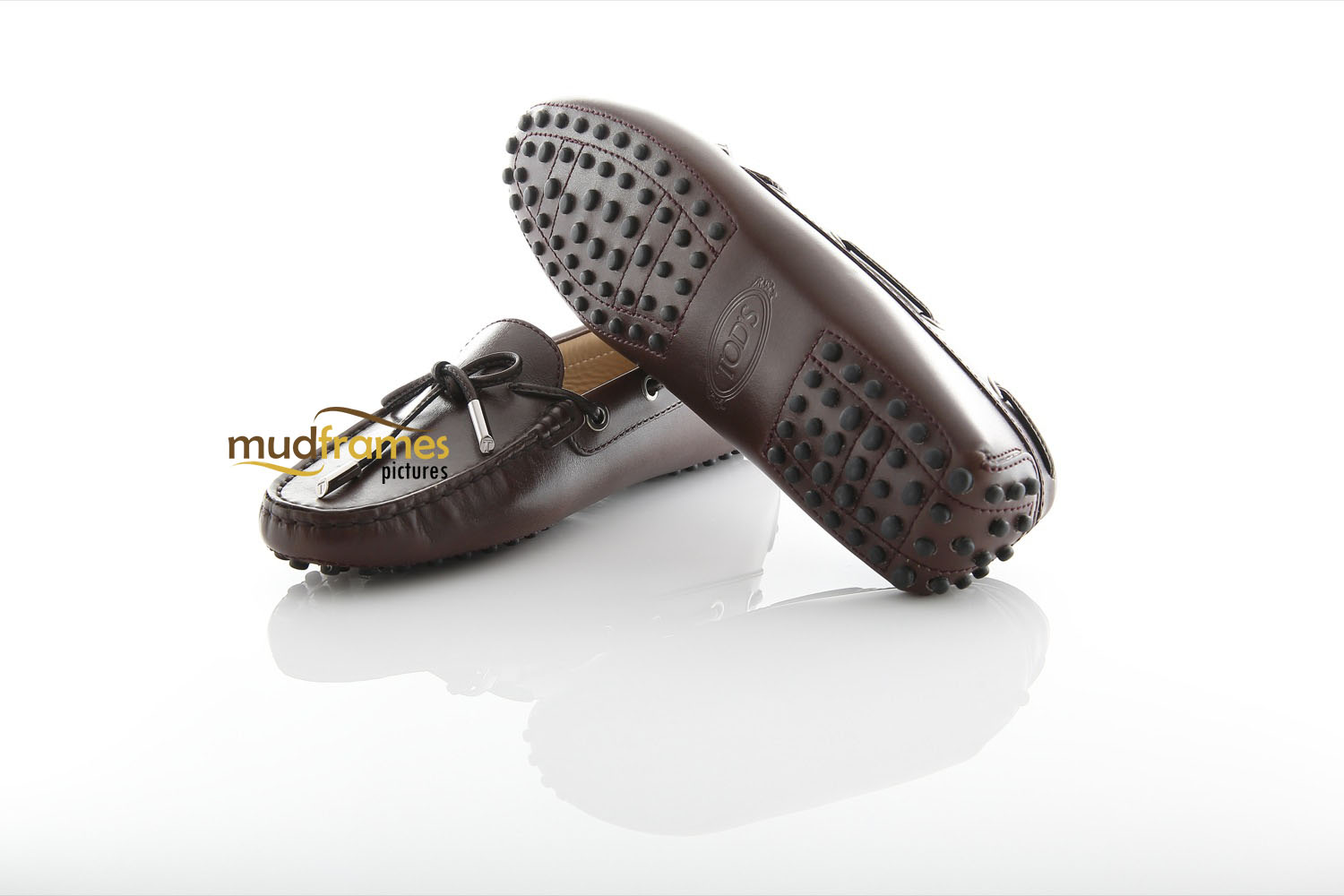 Brown TOD's shoes on white background