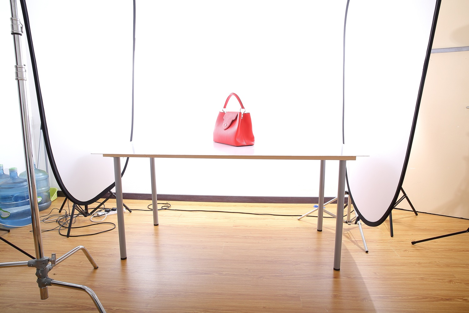 BTS: Photographing a red reflective leather Louis Vuitton Bag
