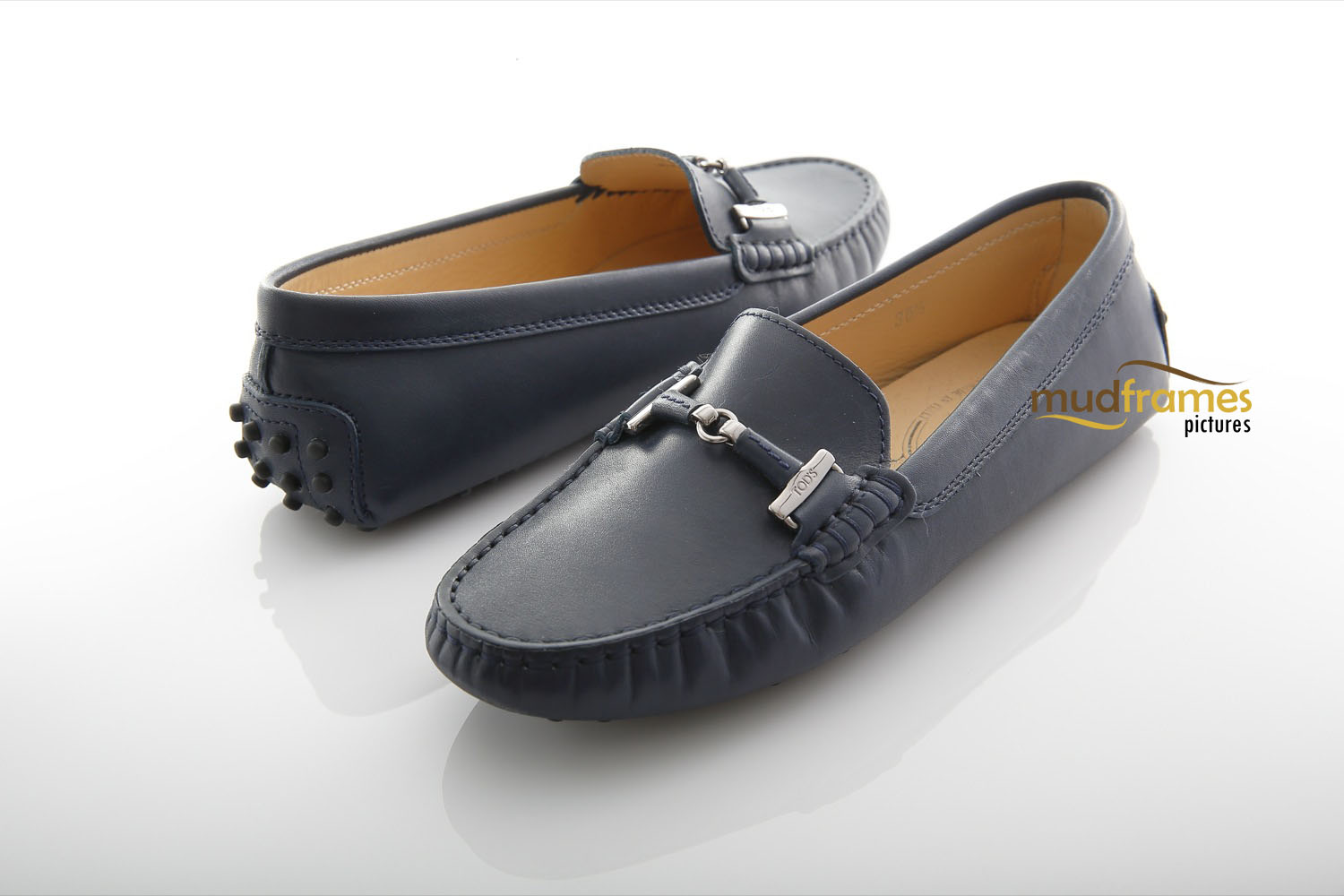 Grey TOD's shoes on white background